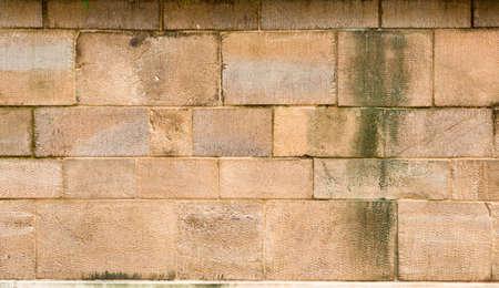 Aged brickwall. Antique masonry or brickwork from different sizes of brick blocks. Retro brick texture or background. Foto de archivo