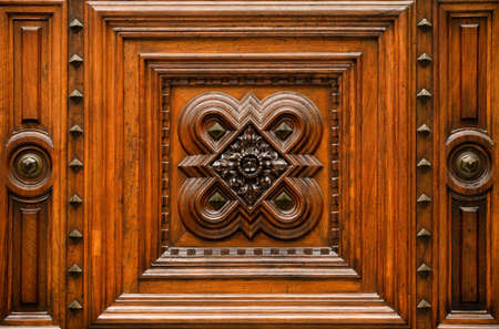 Wood carving with inlay. Fragment of old wooden pattern.