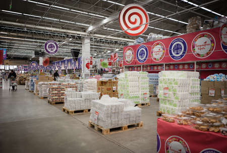 Interior and commodity rows in store of Auchan retail chain during quarantine. March 2020. Kiev, Ukraine.