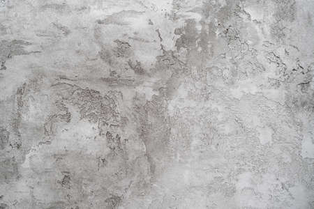 Texture of gray plaster on a white wall. Abstract background or empty blank.