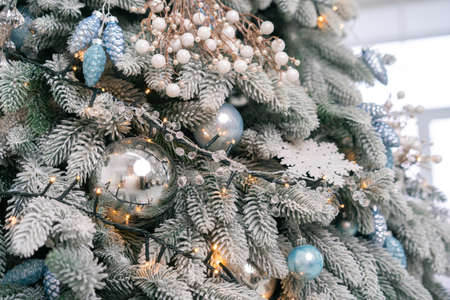 Close up view of decorated Christmas tree. Festive background or wallpaper.