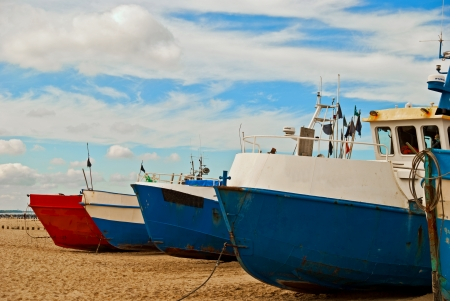 Fishing boats on the Baltic seashore photo