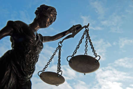 hearing protection: Lady Justice - Temida - Themis on the blue sky Stock Photo