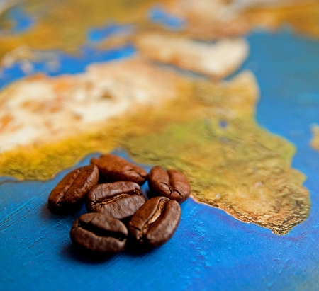 Coffee grains on Africa map photo