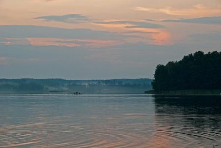masuria: Fishing boat on the lake at sunset in Masuria