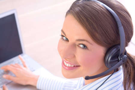 Beautiful woman with headset working in call center photo