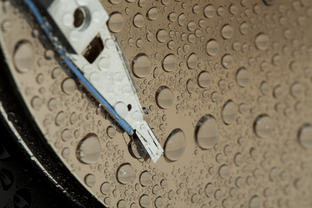 hard drive crash: Hard disk drive with drops of water