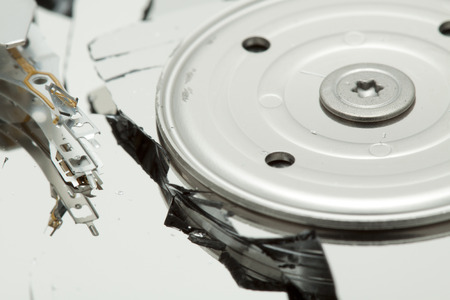 diskdrive: Broken hard drive disk. Macro, focused on magnetic head.
