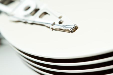 ide: Open computer hard drive disk, narrow focus on read write head