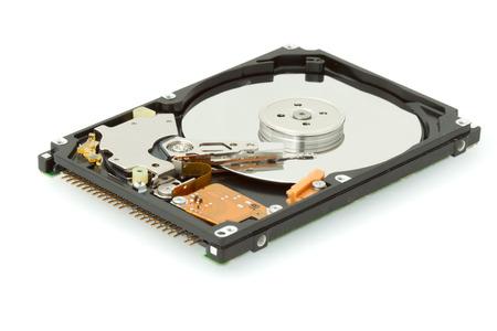 formatting: Broken hard drive disk, macro focused on magnetic head