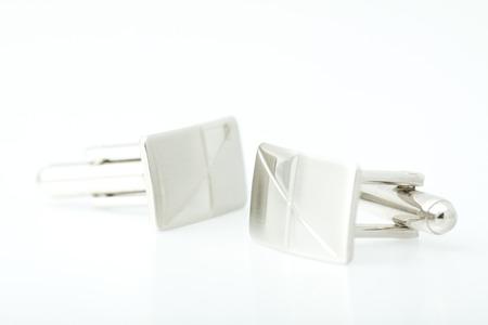 cufflinks: Classic cufflinks on white background