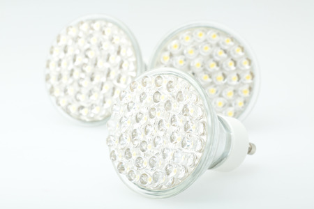 Eco LED light bulb isolated on white background photo