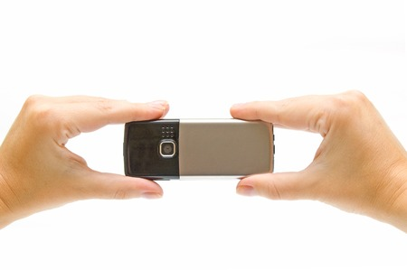 wireles: Mobile phone in woman hands
