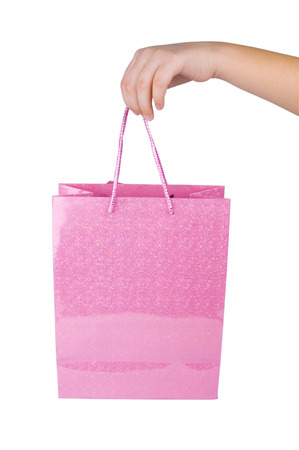 Pink shopping bag in hand photo
