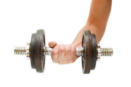 Hand holding dumb-bell Standard-Bild