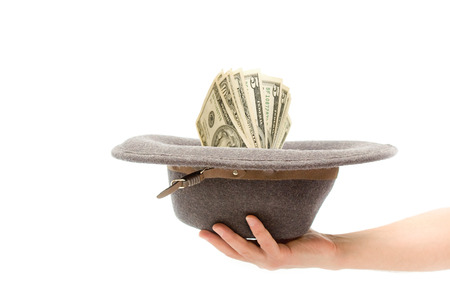 destitution: Hat with money