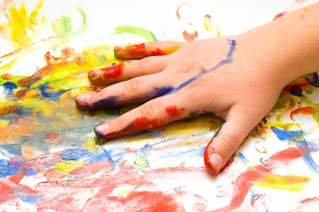 fingerpaint: Painted child hand on colorful