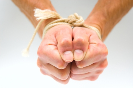 Tied male hands photo