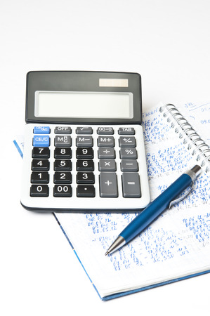 Financial paper, pen and calculator