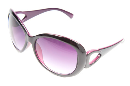 tinted glasses: Female sunglasses isolated on white Stock Photo
