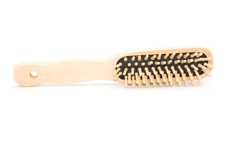 Wooden comb on white background photo