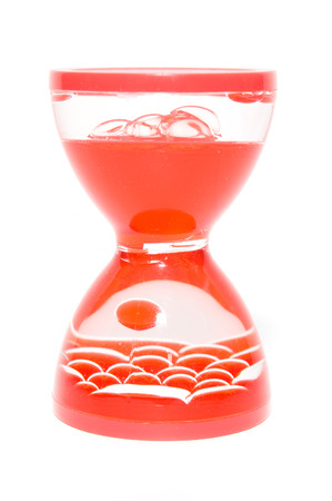 Red hourglass closeup photo