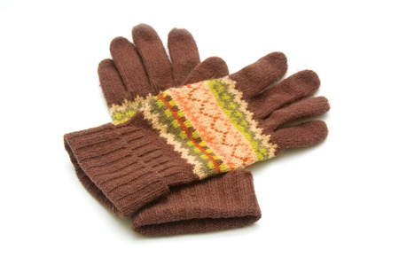 Pair woolen gloves on white photo