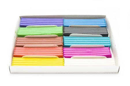 Colourful plasticine pieces in box photo