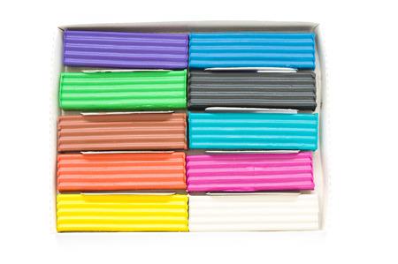 Colorful pieces plasticine closeup photo