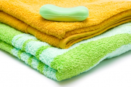 orange washcloth: Towels and soap closeup