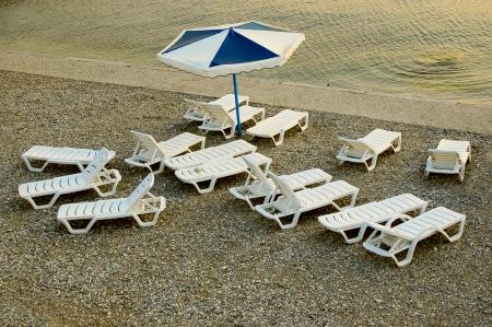 shingle beach: Free seats on shingle beach Stock Photo