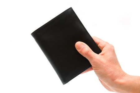 pocketbook: Hand holding black pocketbook Stock Photo