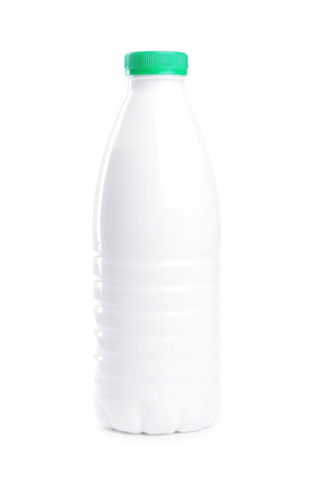 Milk bottle isolated on white background photo