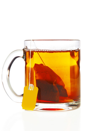 Glass cup with teabag Stock Photo