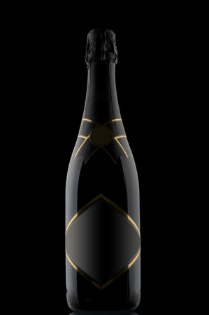 champagne bottle: Champagne bottle on black backdrop
