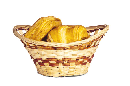 Wicker basket with baked confection photo