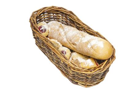 canasta de panes: Cesta de mimbre con confitura al horno