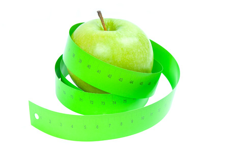 scrawny: Dieting concept  Green apple and tape measurement Stock Photo