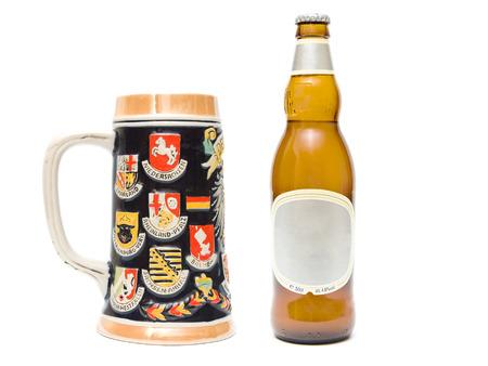 stein: Stein and beer bottle on white