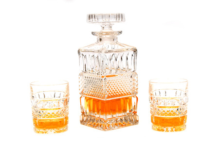 decanter: Crystal decanter and glasses with cognac Stock Photo