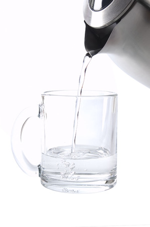 Pouring water from kettle