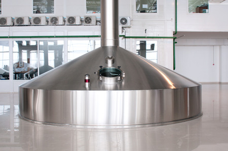 Fermentation vats on brewery plant Stock Photo - 26716934