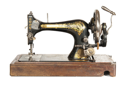 sewing item: Antique sewing-machine  Stock Photo