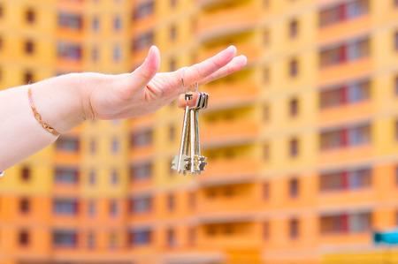 Hand holding keys house Stock Photo