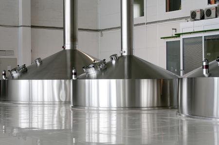 Steel fermentation vats on brewer factory photo