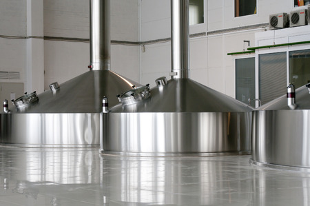 vats: Steel fermentation vats on brewer factory