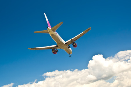 turbulence: Passenger plane flying over clouds Stock Photo