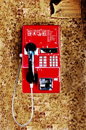 Old public telephone on grunge background photo