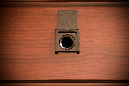 peep: Peep hole on wooden door Stock Photo