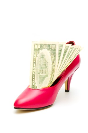 Red women shoe and dollar banknotes photo